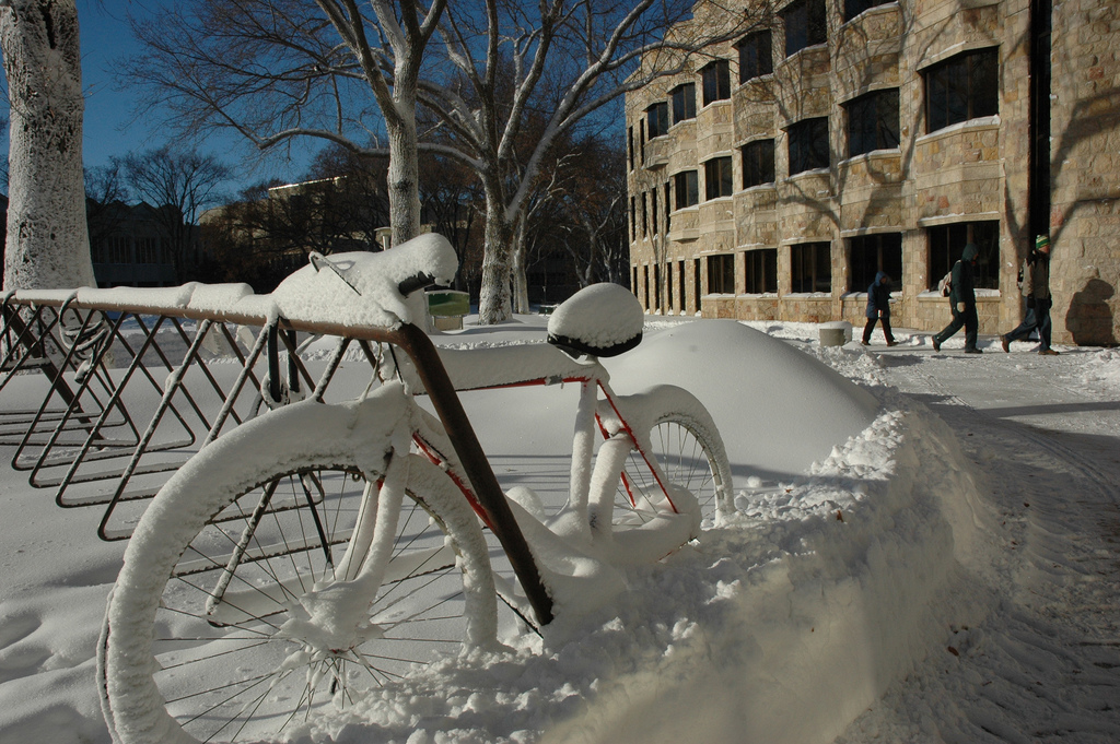 A bike covered in snow at the U of S campus