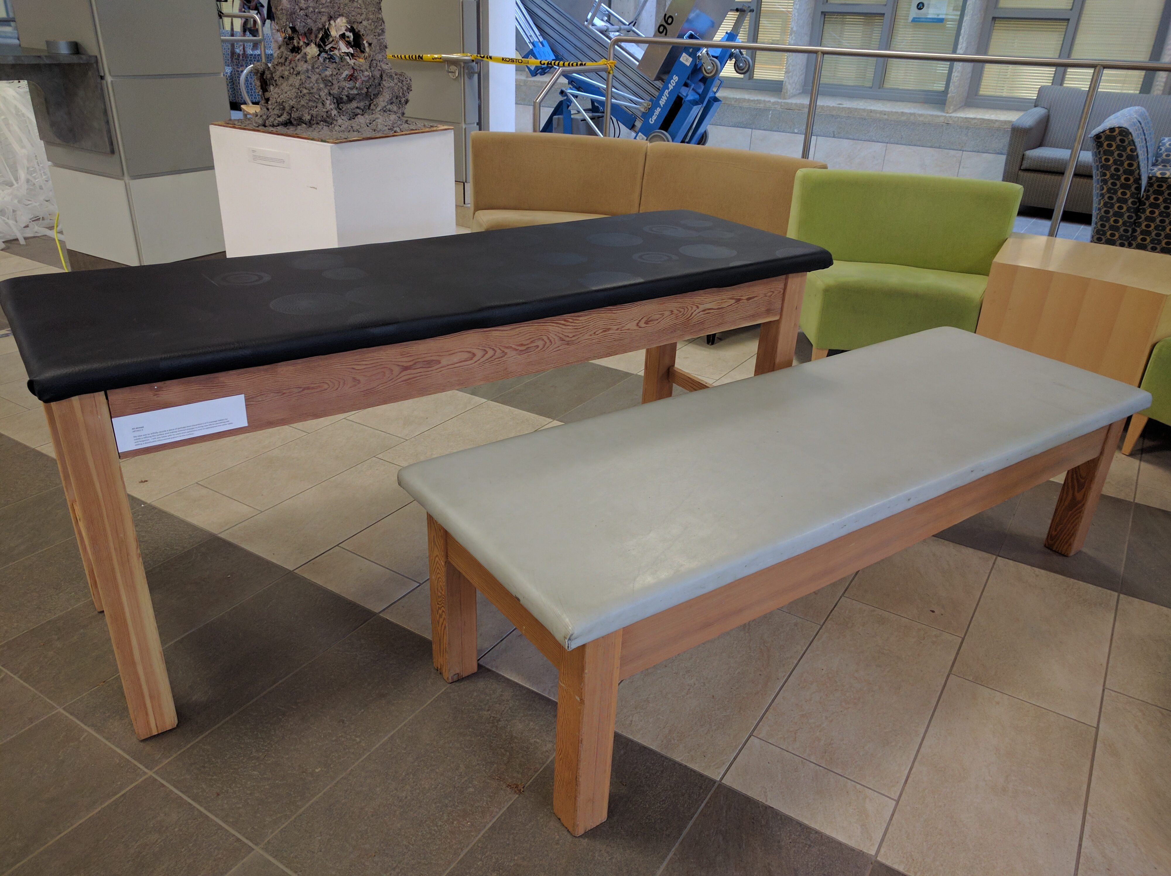 A set of massage tables -- one refurbished -- made by art student Ali Ahmed