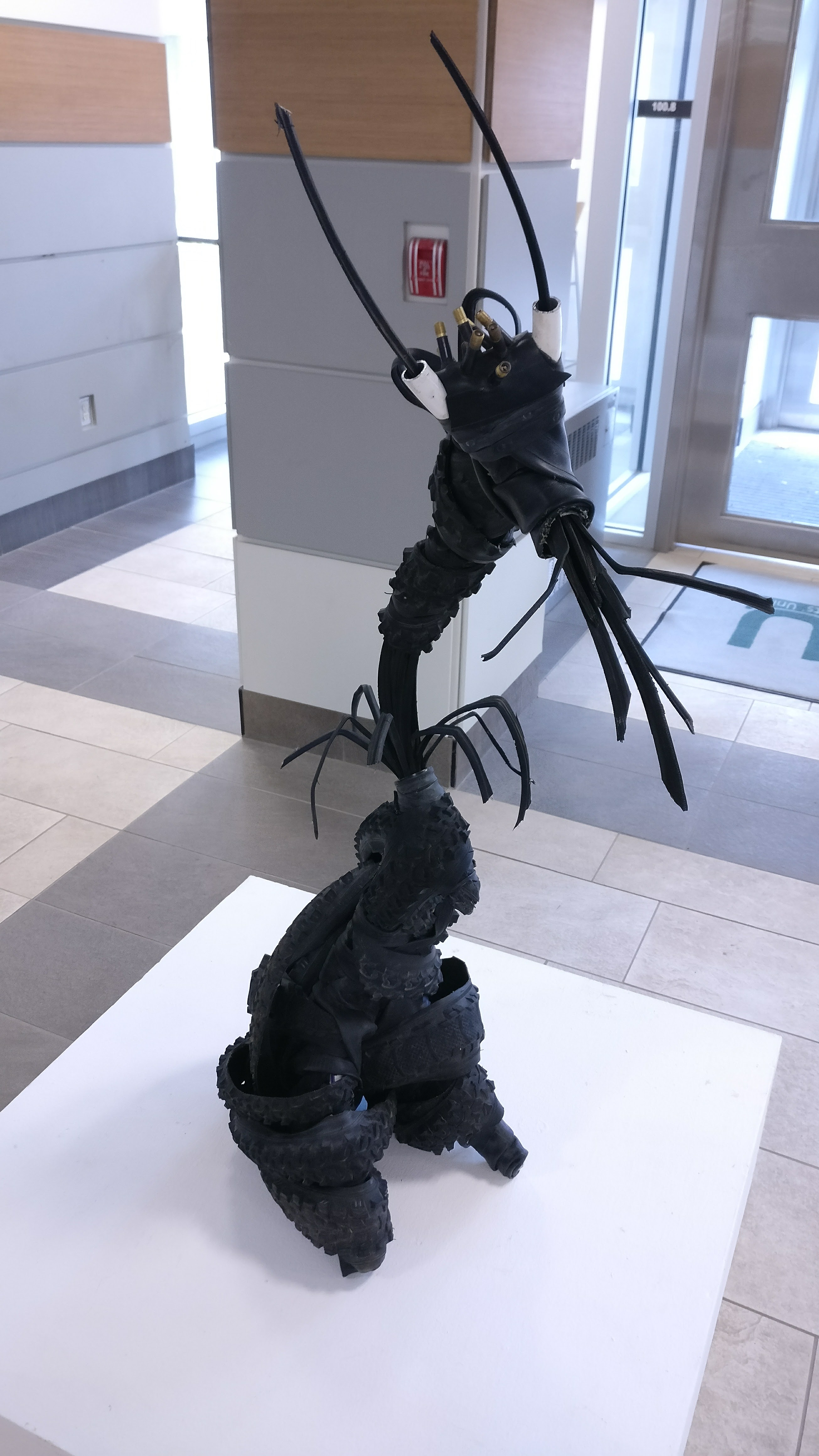 An anthropomorphic creature sculpture made from bike tires and cables by Hailey Jones for ART*Cycled 2017.