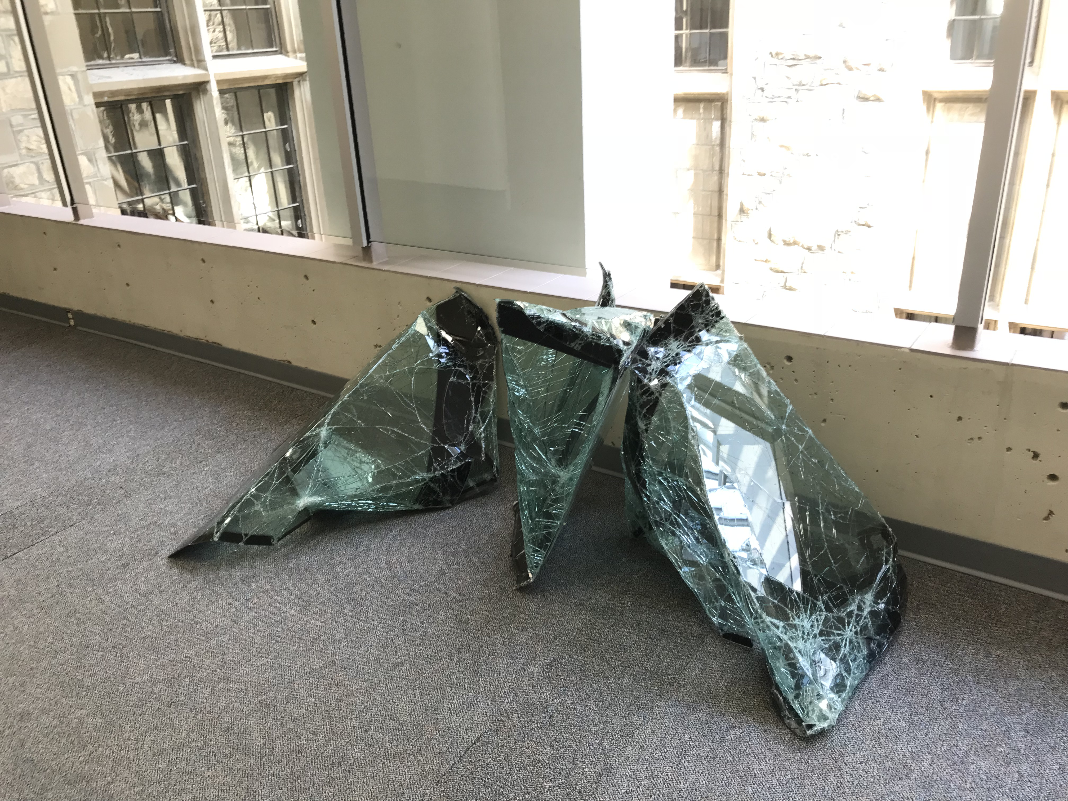 An art project created from discarded and repurposed glass windshields for ARTCycled 2018 by Geoffrey Vaz