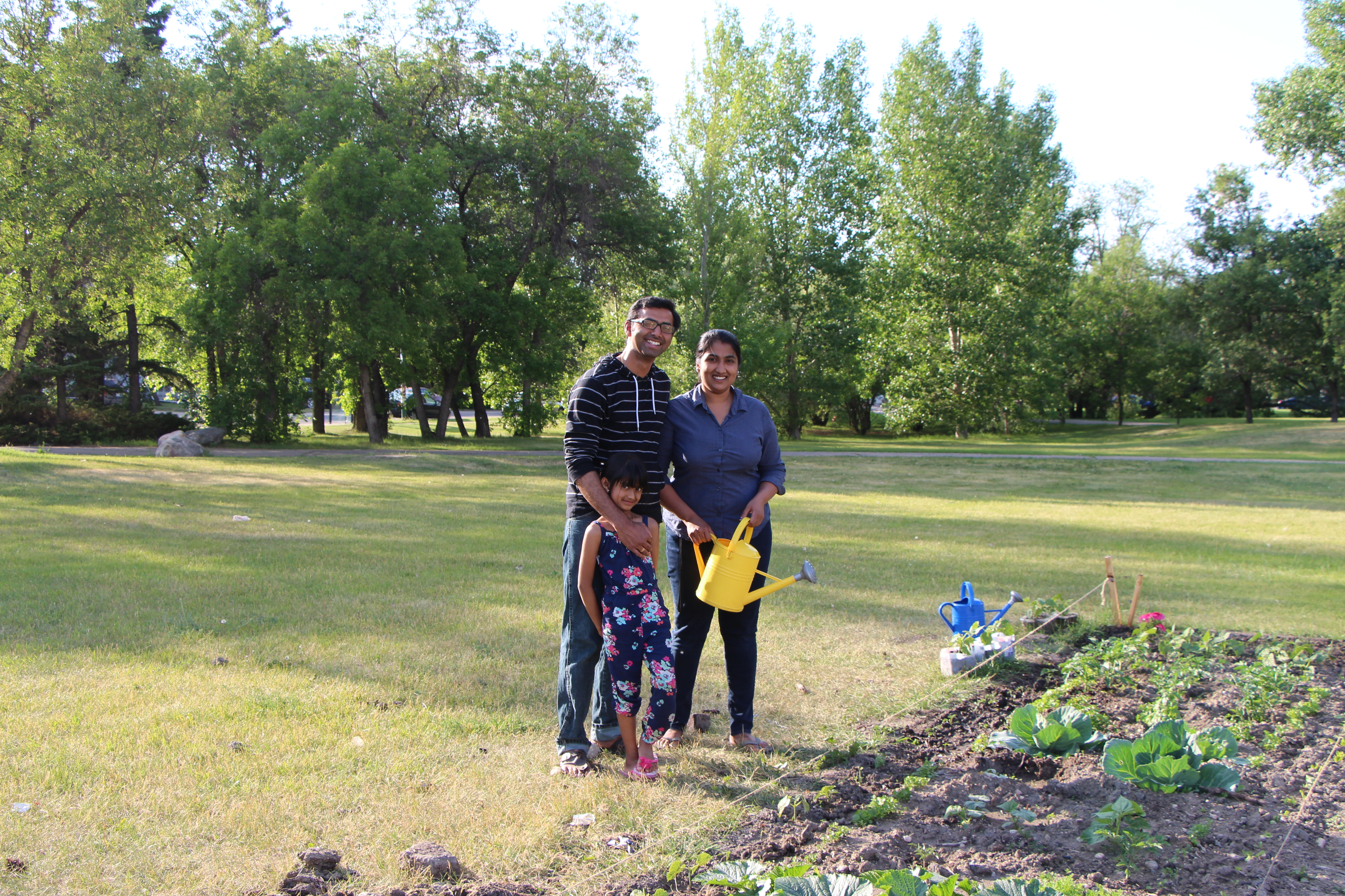 A family of gardeners at the McEown Community Garden